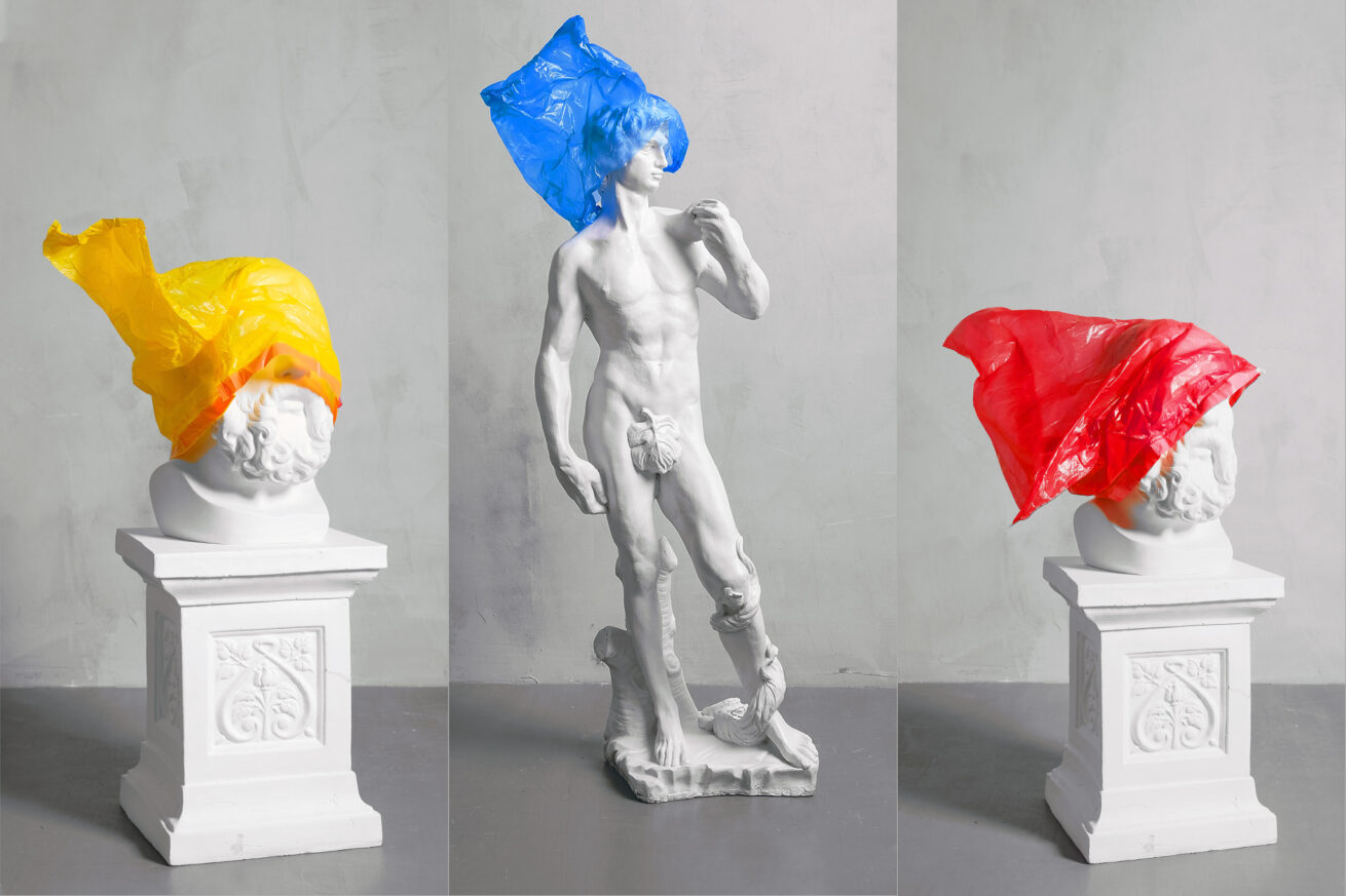 Type of artist & their behaviour with color; three statues with different colored plastic bags